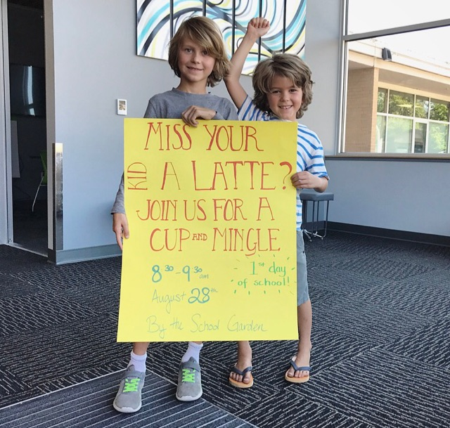 kids holding sign about coffee on first day of school